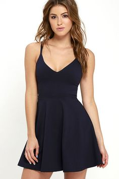 Your future love will never know what hit 'em when you stroll by in the Meet Cute Navy Blue Skater Dress! Medium-weight stretch knit shapes a darted bodice with a V neckline, supported by skinny straps. Flaring, mini-length skirt. Hidden back zipper.