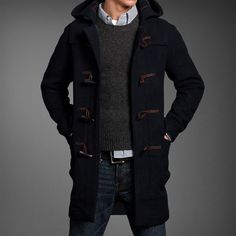 Shop this look for $207:  http://lookastic.com/men/looks/duffle-coat-and-crew-neck-sweater-and-belt-and-jeans-and-longsleeve-shirt/468  — Navy Duffle Coat  — Charcoal Crew-neck Sweater  — Black Leather Belt  — Blue Jeans  — White and Navy Vertical Striped Longsleeve Shirt