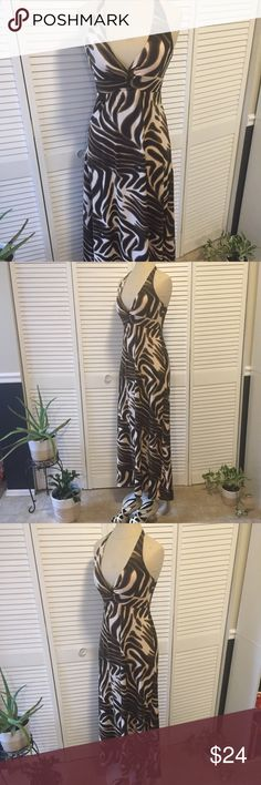 Animal Print Maxi Dress Sleek and comfy this dress checks the boxes...  Sexy, fun and relaxed.  Sitting by the pool or out with friends it works.  Gently worn and is in great condition ! New York & Company Dresses