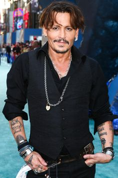 Johnny Depp Photos Photos - Actor Johnny Depp attends the premiere of Disney's 'Pirates Of The Caribbean: Dead Men Tell No Tales' at Dolby Theatre on May 18, 2017 in Hollywood, California. - Premiere of Disney's 'Pirates of the Caribbean: Dead Men Tell No Tales' - Red Carpet
