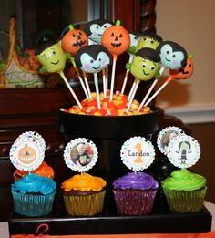 Halloween 1st Birthday Party Idea...love the pops and cupcakes mixture