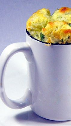 Souffle' Single Serve Cheddar and Spinach IN A CUP!  Great idea for company! LOTS of photo instructions.  there is a trick to get a savory souffle' to rise PERFECT everyctime and it is all in this post.  Dramatic beautiful and cheesy goodness... and I promise, your souffle' will rise PERFECT!