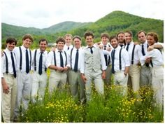 This is a good idea...the groomsmen in suspenders and the groom in a vest. Hm..