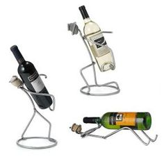 Steel and Stone Wine Holders pricey but excellent wedding gift idea for a special wine loving couple who are older and merging two households from UNCOMMON GOODS URL www. Welding Art Projects, Metal Art Projects, Metal Crafts, Welded Furniture, Wine Bucket, Wine Collection, Scrap Metal Art, Wine Bottle Holders, Beer Bottle