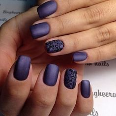 Matte purple nails with black scroll design accent