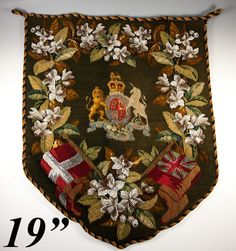 Another Victorian era beadwork and needlepoint fire screen panel, large and lush with florals and flags and the English Royal crest at center. This