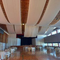 Strip draping and fairy lights in the ceiling International School, Draping, Fairy Lights, Corporate Events, Backdrops, Ceiling, Decor, Ceilings, Decoration