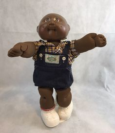 Adorable collectible doll. Doll is in good preowned condition, there is a stain on the logo on his Coveralls.   eBay!