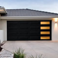 Mosaic garage door windows creates a mid century and modern look. | Amarr Doors Contemporary Garage Doors, Modern Garage Doors, Garage Door Styles, Garage Door Design, Modern Exterior Doors, Mid Century Modern Door, Mid Century Exterior, Mid Century House, Garage Door Windows