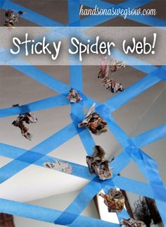 "Sticky Spider Web - fine motor, sensory.  You could also do this on a table and have kids drive cars on certain color ""roads"" for fine motor and color recognition."