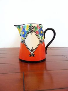 Czech Pottery Pitcher Medley Art Deco Orange Vintage Floral Pitcher    This fabulous pitcher in vibrant orange will instantly add interest, color