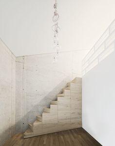 Steimle Architekten designed the three-storey family house across a split-level site in Pliezhausen