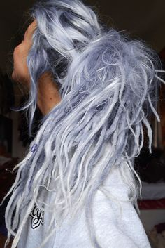 dreads and pale blue/gray/lilac
