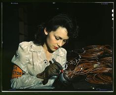 Woman aircraft worker, Vega Aircraft Corporation, Burbank, CA, 1942 by David Bransby via the Library of Congress via Flickr: Shown checking electrical assemblies. #Woman #Vega_Aircraft #David_Bransby #The_Library_of_Congress #Flickr