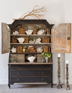 Styled bookcase in distressed hutch