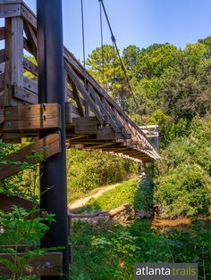 Top dog-friendly and family-friendly hikes in Atlanta: hike or run the scenic Morningside Nature Preserve Trail, crossing a tall swinging bridge over South Peachtree Creek