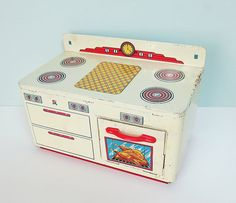 Lets play house! Made in the 1940s, this Oho Art toy stove is truly charming and would be a welcome addition to a vintage-inspired kitchen, toy collection