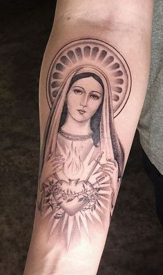 Virgin Mary is the symbol of purity and motherly affection. Check our collection of 75 Virgin Mary tattoos for your next ink. Wrist Tattoos For Guys, Cool Forearm Tattoos, Finger Tattoos, Leg Tattoos, Body Art Tattoos, Mary Tattoo, I Tattoo, Virgen Maria Tattoo, Money Sign Tattoo