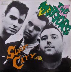 The Meteors - Anagram Record # 31 - 45 rpm - 1986 | Side A - Surf City Side B - The Edge .  P. Paul Fenech - Vocals & Lead Guitar. Ian 'Spider' Cubitt - Drums. Austin. H. Stones - Bass.