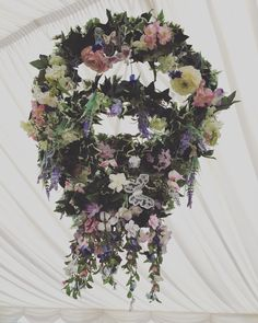 Wedding chandelier made from garden hose, ribbon, fishing line, fake Ivy and fake flower heads. Serena and Robins wedding 15/7/17