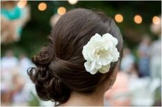 side updo with a flower for the reception