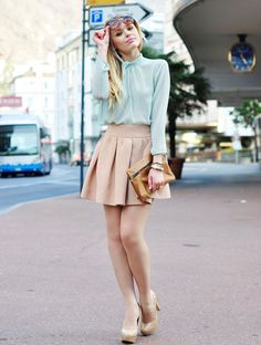 chiffon blouse with nude pleated skirt and nude pumps