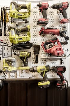 Amazing metal pegboard system for the garage! Learn how to install Wall Control metal pegboard system for the shop with these great garage organization ideas! Love the design of this modern organization system that any woodworker would love! Learn how to extend an outlet through a metal pegboard so that it will fit anywhere! #organization #pegboard #garage #WallControl #review #shop