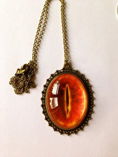 The Eye Of Sauron - Lord Of The Rings Inspired Necklace - With Long Bronze Chain And Made With Love Charm