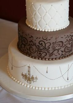 I know this doesn't have peonies but I think the shape of the cake is nice but with sharper edges. Different textures for each tier is another idea. Keep the top the same, a royal icing stencil in the middle and plain on the bottom? Can have the ribbon around the bottom instead of piping.