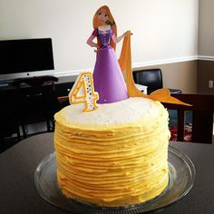 Rapunzel Party cake --- uh... tried to get this look... it was horrible. In my attempt to fix it I used a LOT of frosting and by the time the party started the cake was drooping frosting!! Emma loved it though :) Topped it with a little toy Rapunzel doll.