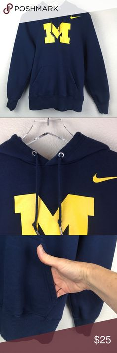 "Nike Michigan Wolverine Logo Club Fleece Hoodie This is University of Michigan wolverine hoodie Has front pouch pocket Drawstring on hood Knit ribbed cuffs and waist Pull over Officially licensed Top of M has a tiny little crack please check pictures Length 24"" Sleeve 25"" Armpit to armpit 21"" All measurements are approximate  W-D Nike Shirts Sweatshirts & Hoodies"