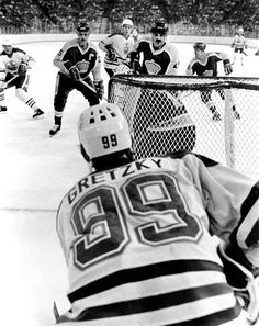 Such a great photo! Everyone is looking at the Great One, wondering what he's going to do.  Wayne Gretzky in his office.