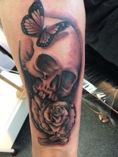 skull, butterfly, rose tattoo