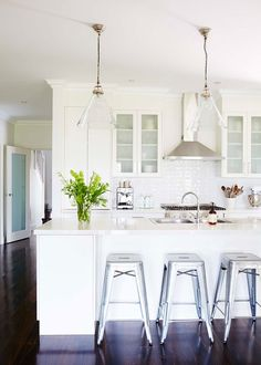 Classic All White Kitchen With Stainless Steel Bar Stools Adding A  Contemporary Touch | Home