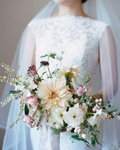 The bride's bouquet was filled with café au lait dahlias, pink snowberry, butterfly ranunculus, and distant drum roses that popped against the Jackson Hole scenery. Fall Wedding Flowers, Flower Bouquet Wedding, Floral Wedding, Bouquet Flowers, Burgundy Wedding, Bridal Flowers, Autumn Wedding, Floral Bouquets, Spring Wedding