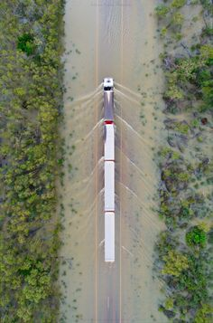 Road Train driving through 'the wet' monsoon season in the north of Western Australia. Train Truck, Road Train, Western Australia, Australia Travel, Broome Australia, Cool Trucks, Big Trucks, White Truck, Truck Design