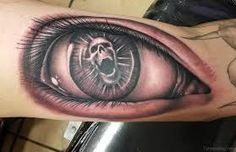 Image result for eye tattoo with a skull for the eye ball and a clock