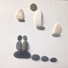 Pebble picture. Watching the Boats. Shells and pebbles