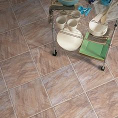 This I would love to have on our kitchen floor. It reminds me of the stone and tile I have seen and loved in the Southwest.