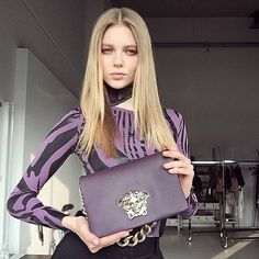 #Repost @katya.ledneva Working hard. Rocking this gorgeous limited edition Versace bag ❤️ Thank you @versace_official @donatella_versace @angelo.azzena @carmen.manno  #hair #makeup by @nataliefranz1 #sexy #topmodel #versace #katyaledneva #aquarellemodels #pictureparkstudios #wewebfashion