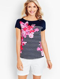 Beautiful flowers, with a hand-painted-like finish, bring new life to a basic stripe tee. The easy fit and cozy-soft fabric give this shirt its classic appeal, while the eye-catching graphic lends modern interest.
