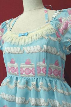 Blue dress with pink strawberries. Japanese Lolita fashion.