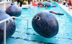 Why toss around a boring old beach ball in the pool when you can toss around a cute giant boulder.