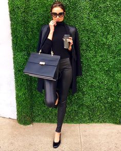 Olivia Culpo's all black outfit. Love the combo of the turtleneck and leather pants with flats.
