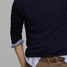 Any man can wear a dark blue sweater over a light blue shirt, tan pants and brown shoes and look great. You can't go wrong.