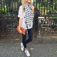 Fall outfit with a striped scarf and New Balance sneakers