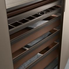 tie rack, organizer tray and pull-out baskets in castoro regenerated leather fi nishing.