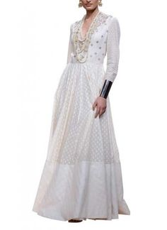 The classy creamy shade of Anita Dongre's jacquard gown makes for the perfect elegant ensemble for weddings or any special occasion. Available on strandofsilk.com, it features intricate gota pati embroidery placed perfectly along the yoke. Finish off the look with a pair of white heels and a delicate pearl necklace for a pure refined look #anitadongre #jacquard #handwoven #gotapati #embroidery #wedding #elegant #refined #stunning