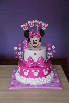 Minnie Mouse cake by ZaklinaYou can find Mickey cakes and more on our website.Minnie Mouse cake by Zaklina Mini Mouse Birthday Cake, Mini Mouse Cake, 1st Birthday Cake For Girls, Minnie Mouse Birthday Decorations, Minnie Mouse First Birthday, Mickey Mouse Cupcakes, Minnie Mouse Theme, Baby Birthday Cakes, Mickey Birthday