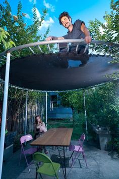 Builder and remodeler Jesse Hartman used a trampoline to shade the patio at the East Austin home he shares with his wife, Diana, and son, Harvey.